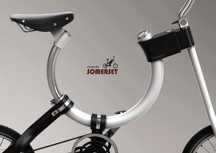 Não sei ao certo se essa bicicleta da Somerset ainda pode ser considerada uma bike. Afinal, essa é a menor bicicleta dobrável que já vi e seu visual baseado em uma forma que me lembra uma ferradura, deixa tudo ainda mais estranho. Mas é isso que transforma essa bicicleta em algo especial.