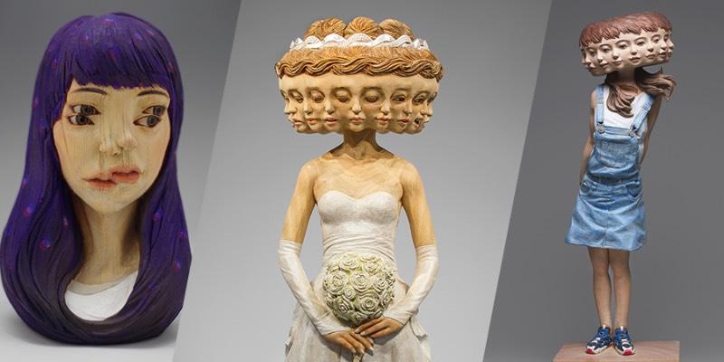Yoshitoshi Kanemaki é um escultor japonês que abandonou a temática tradicional em direção a algo mais surreal e moderno, utilizando até de glitch em sua arte. Feitas de madeira, suas esculturas são maiores do que a realidade e desafiam as regras da anatomia, as proporções físicas e tudo aquilo que estamos acostumados de ver no corpo humano. Algumas vezes, suas esculturas aparecem com figuras faciais fora do comum, outras vezes elas se multiplicam como no caso de sua escultura de 12 faces femininas. Outras vezes, somos presenteados com olhos a mais e com cenários que mais parecem ter vindo de um sonho do que da realidade em si. Eu virei fã.